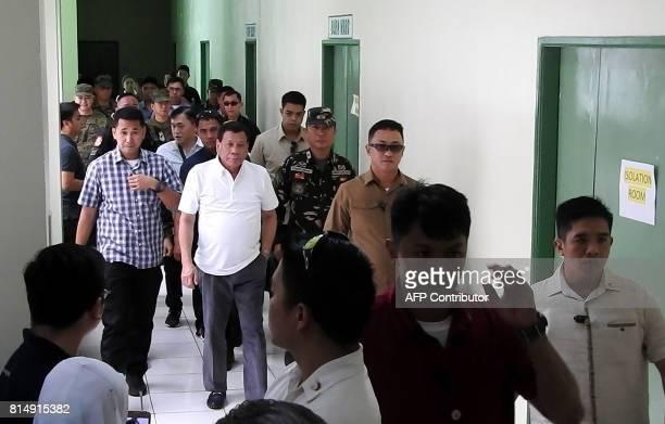 Philippine's president Rodrigo Duterte arrives at the Camp Teodulfo Bautista hospital in Jolo Sulu on the southern Philippine island of Mindanao on...
