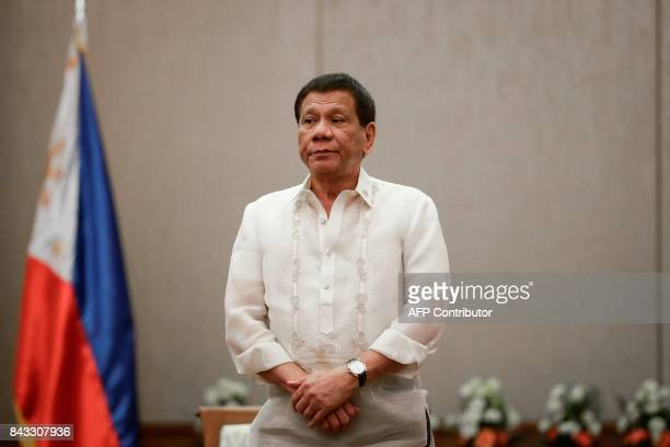 Philippines' President Rodrigo Duterte looks on during a courtesy call with Association of Southeast Asian Nations Economic Ministers in Manila on...