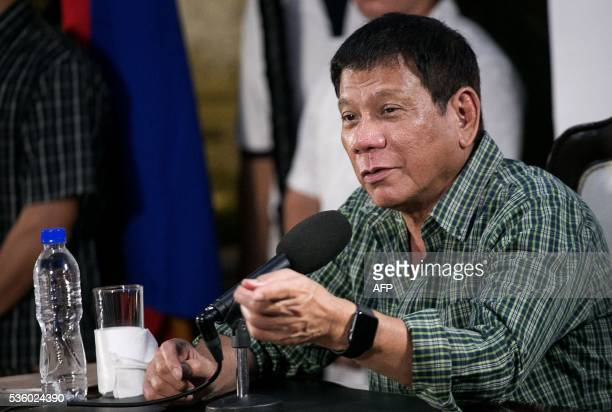 Philippines' presidentelect Rodrigo Duterte speaks during a press conference in Davao on May 31 2016 Philippine presidentelect Rodrigo Duterte's war...