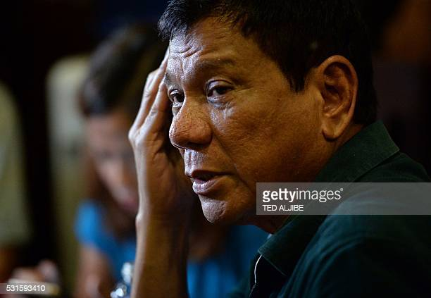 Philippines' Presidentelect Rodrigo Duterte speaks to the media for the first time asince he claimed victory in the presidential election at a...