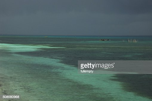 Philippines sea and fisher man on moonson storm : Stock Photo