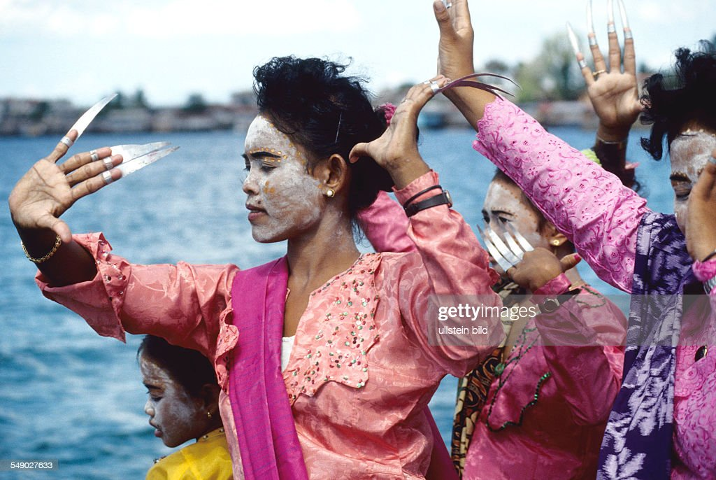 A Badjao wedding party on a boat off the island of Bongao The Brides maids dance a traditional dance