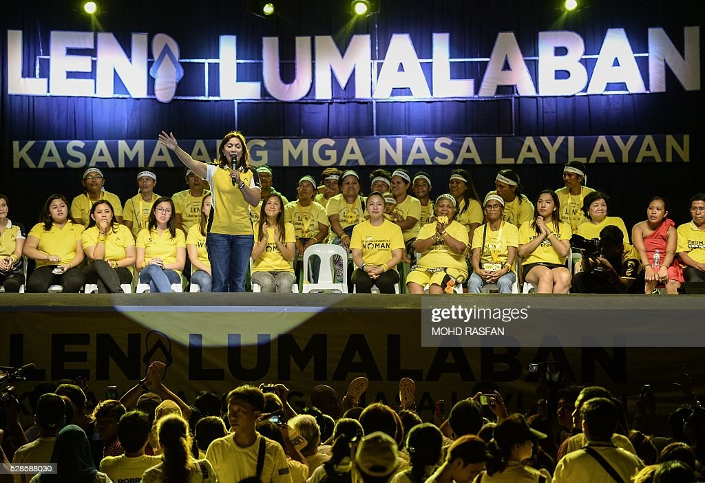 Philippines vice presidential candidate Leni Robredo addresses her supporters during a campaign rally in Manila on May 6, 2016. Anti-establishment Philippine politician Rodrigo Duterte's rollicking ride to presidential favouritism has triggered warnings of a coup should he win next week's election, with opponents warning he is a dictator in the making. / AFP / MOHD