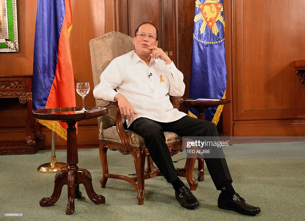 Philippines-politics-rights-Aquino-Marcos,FOCUS by Karl Malakunas This photo taken on April 14, 2015 during an interview with AFP shows Philippine President Benigno Aquino speaking at the Malacanang Palace in Manila. In a lengthy interview with AFP this week from the presidential palace that was once the domain of his nemesis, Aquino offered rare insights into his struggle to ensure anger did not impact his running of the country. AFP PHOTO / TED ALJIBE