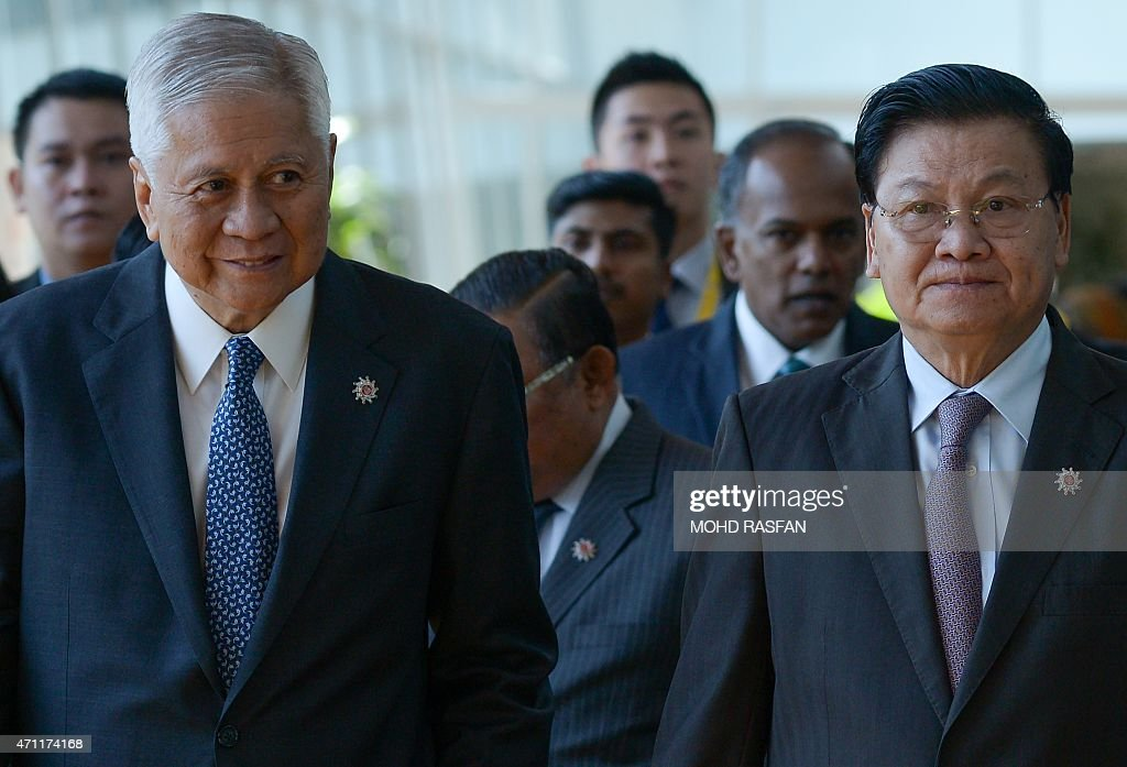 Philippines's Foreign Affairs Minister Albert del Rosario and Laos' Foreign Minister Thongloun Sisoulith arrive for the ASEAN Foreign Ministers...