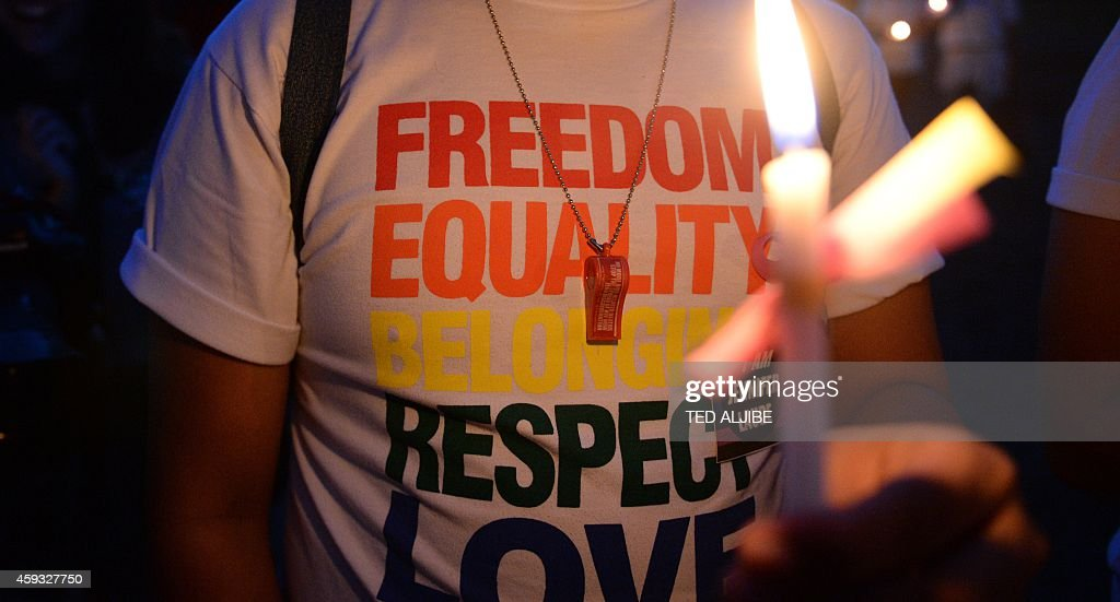 PhilippinesUSdiplomacycrimediscriminationsexFEATURE by Mynardo Macaraig In this photo taken on October 25 2014 shows a supporter of Lesbiangay and...