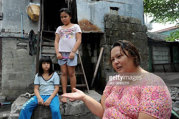 PhilippinesUSmilitaryfamilychildrenFEATURE by Jason GUTIERREZ This photo taken on May 29 2014 shows Beirut Calaguas gesturing as she narrates her...