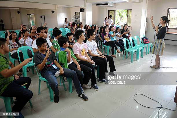 PhilippinesvotereligionCatholicFOCUS by Mynardo Macaraig Anna Cosio Catholic Vote Philippines Secretary lectures the parisioners while delivering...