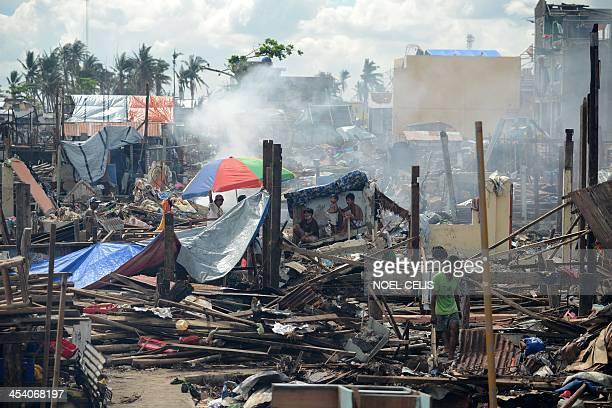 PhilippinesweathertyphoonhopeFOCUS by Karl MALAKUNAS Typhoon survivors rest on a makeshift house among debris of destroyed houses in Tacloban Leyte...