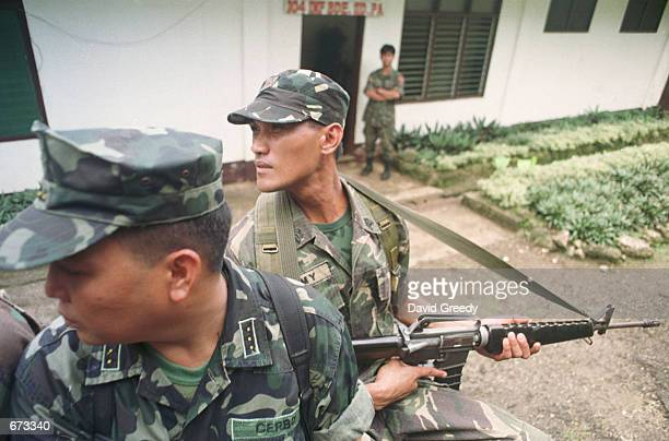 Philippino soldiers stay alert as they are patrol November 25 2001 on the island of Jolo a day before elections to chose a new governor in the...