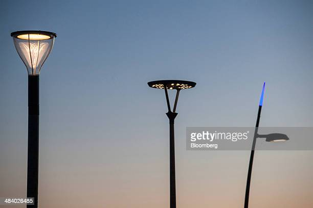 A Philips Metronomis light emitting diode Fluid light left a Philips UrbanScene light center and a mini CitySoul light emitting diode street lights...