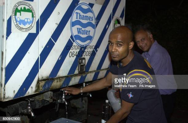 Philjeus Couloutee from Streatham south London fills a container from an emergency water supply bowser About 9000 homes were without water supplies...