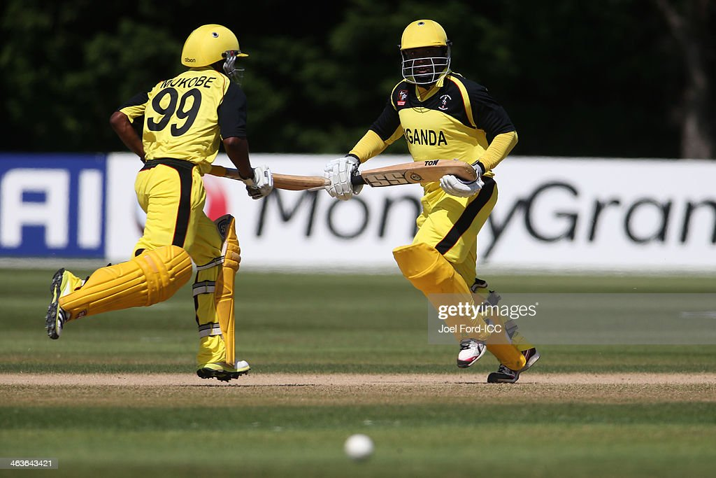 Phillemon Selowa Mukobe and Abram Ndhlovu Mutyagaba of Uganda run between the wickets during an ICC World Cup qualifying match against Kenya on January 19, 2014 in Mount Maunganui, New Zealand.