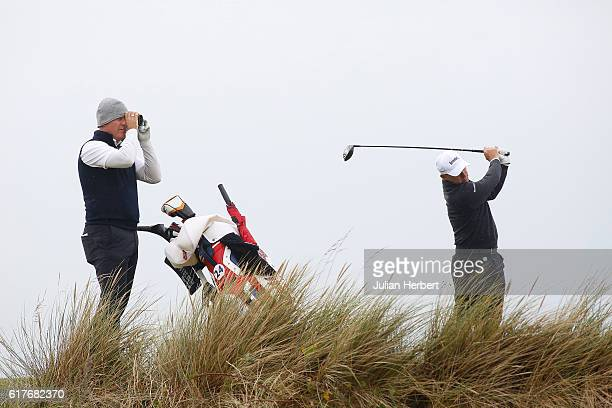 Phillip Archer of Birchwood Golf Club looks on as Robert Coles takes a practice shot during day one of The 2016 PGA PlayOffs at Saunton Golf Club on...