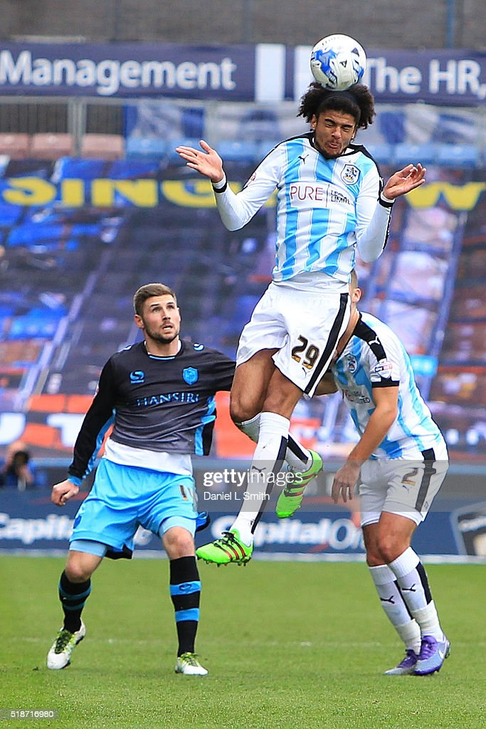 Phillip Billing of Huddersfield Town FC heads the ball during the Sky Bet Championship match between Huddersfield Town and Sheffield Wednesday at Galpharm Stadium on April 2, 2016 in Huddersfield, United Kingdom.