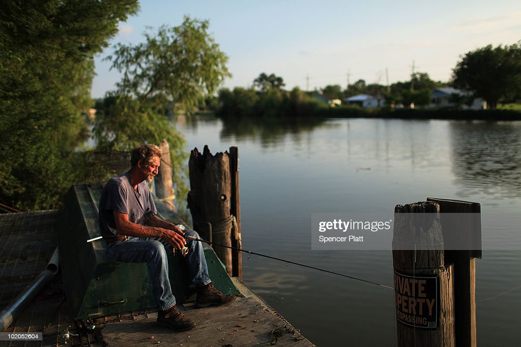 Phillip Boudreaux fishes for catfish along a bayou June 13 2010 in Lafourche Louisiana Commercial fishing including areas in Lafourche has been...