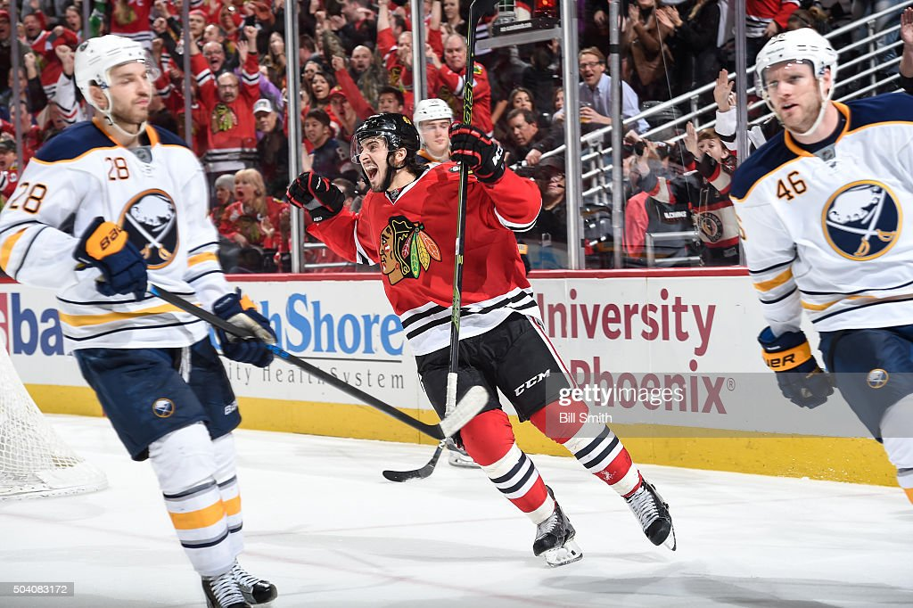 Phillip Danault of the Chicago Blackhawks celebrates after scoring his first NHL goal in the third period of the NHL game against the Buffalo Sabres...