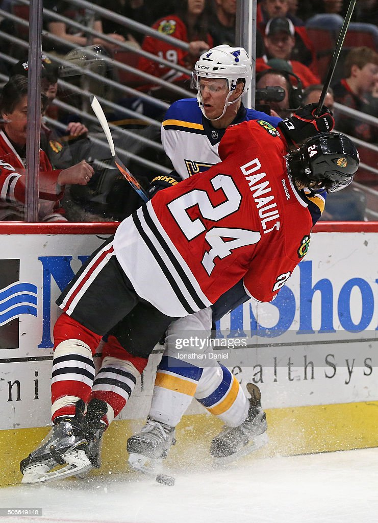Phillip Danault #24 of the Chicago Blackhawks collides with <a gi-track='captionPersonalityLinkClicked' href=/galleries/search?phrase=Carl+Gunnarsson&family=editorial&specificpeople=5557315 ng-click='$event.stopPropagation()'>Carl Gunnarsson</a> #4 of the St. Louis Blues as they battle for the puck at the United Center on January 24, 2016 in Chicago, Illinois. The Blackhawks defeated the Blues 2-0.