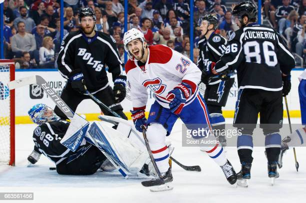 Phillip Danault of the Montreal Canadiens celebrates a goal against goalie Andrei Vasilevskiy and the Tampa Bay Lightning during second period at...