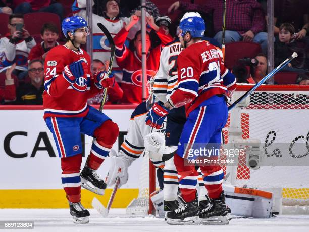 Phillip Danault of the Montreal Canadiens celebrates a third period goal with teammate Nicolas Deslauriers against the Edmonton Oilers during the NHL...
