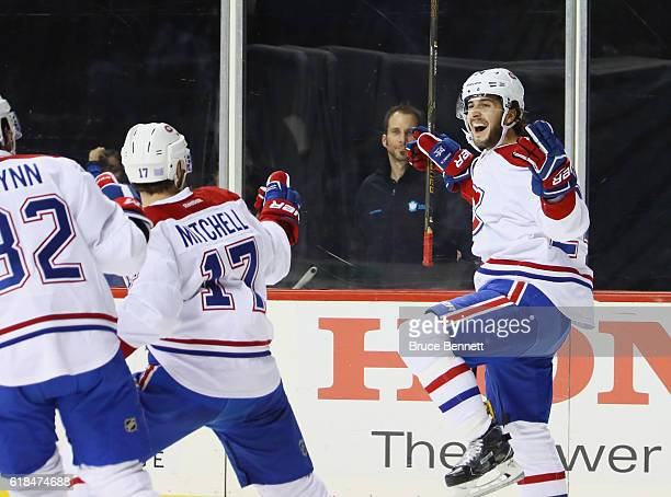 Phillip Danault of the Montreal Canadiens celebrates his third period goal against the New York Islanders at the Barclays Center on October 26 2016...