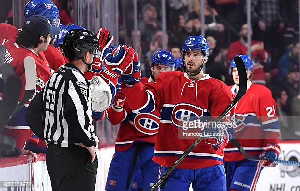 Phillip Danault of the Montreal Canadiens celebrates with the bench after scoring a goal against the Buffalo Sabres in the NHL game at the Bell...