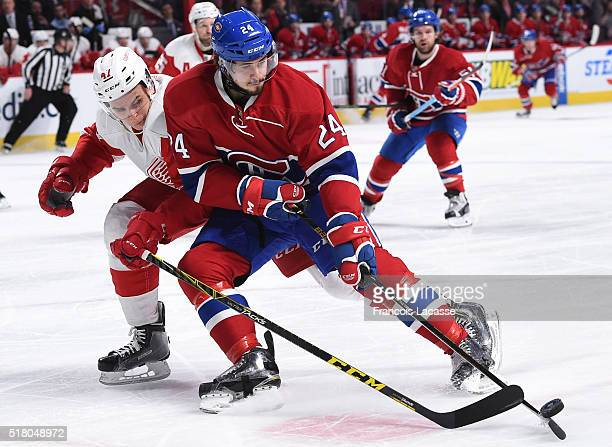 Phillip Danault of the Montreal Canadiens controls the puck against Alexey Marchenko of the Detroit Red Wings in the NHL game at the Bell Centre on...