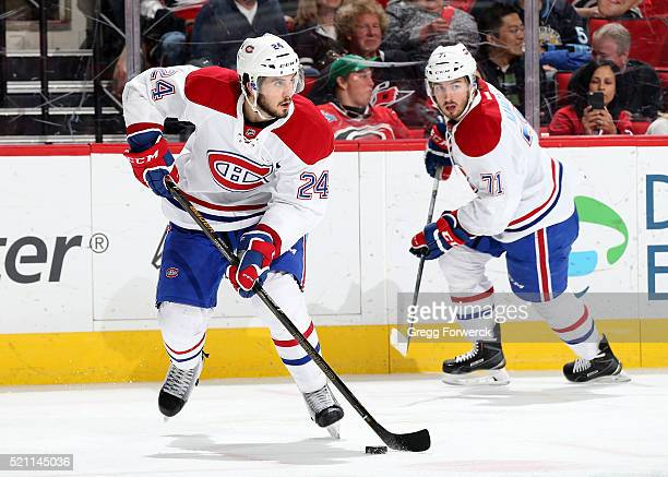 Phillip Danault of the Montreal Canadiens controls the puck on the ice along side teammate Joel Hanely during an NHL game against the Carolina...