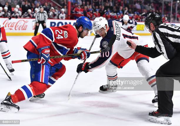 Phillip Danault of the Montreal Canadiens face off against Alexander Wennberg of the Columbus Blue Jackets in the NHL game at the Bell Centre on...
