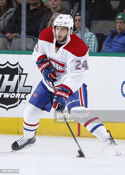 Phillip Danault of the Montreal Canadiens handles the puck against the Dallas Stars at the American Airlines Center on January 4 2017 in Dallas Texas