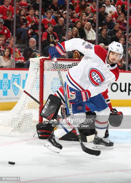Phillip Danault of the Montreal Canadiens hits the puck in the first period against the Chicago Blackhawks at the United Center on November 5 2017 in...