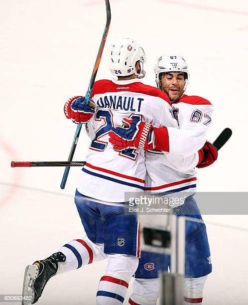 Phillip Danault of the Montreal Canadiens jumps into teammate Max Pacioretty arms after scoring in overtime for 32 win against the Florida Panthers...
