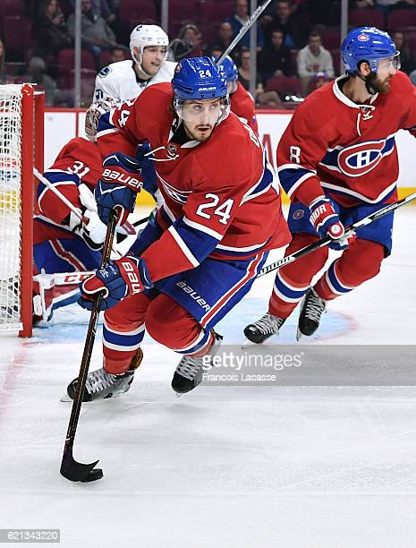 Phillip Danault of the Montreal Canadiens looks to pass the puck against the Vancouver Canucks in the NHL game at the Bell Centre on November 2 2016...