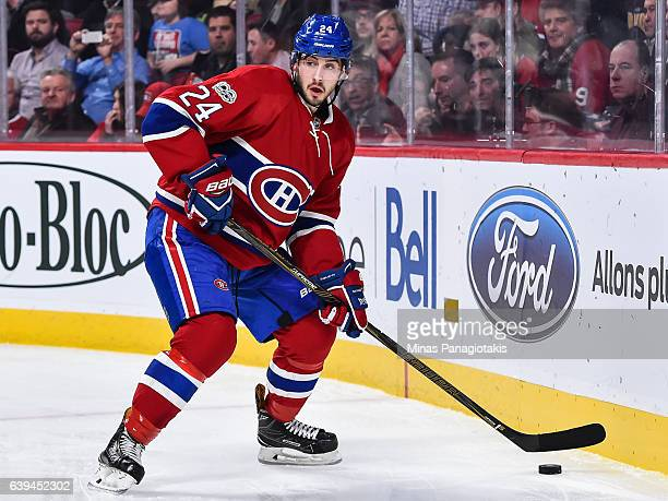 Phillip Danault of the Montreal Canadiens looks to play the puck during the NHL game against the Pittsburgh Penguins at the Bell Centre on January 18...