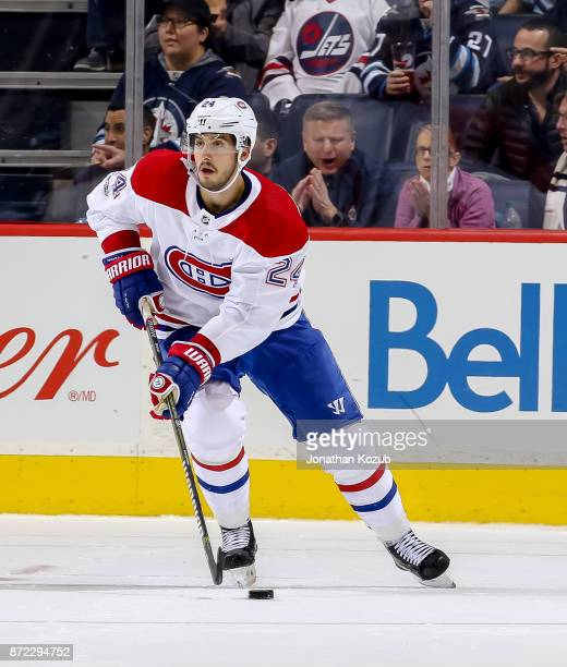 Phillip Danault of the Montreal Canadiens plays the puck down the ice during third period action against the Winnipeg Jets at the Bell MTS Place on...