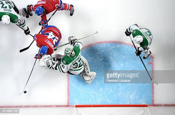 Phillip Danault of the Montreal Canadiens scores a goal against Kari Lehtonen of the Dallas Stars in the NHL game at the Bell Centre on March 8 2016...