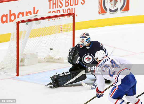 Phillip Danault of the Montreal Canadiens shoots the puck past goaltender Michael Hutchinson of the Winnipeg Jets for a second period goal at the MTS...