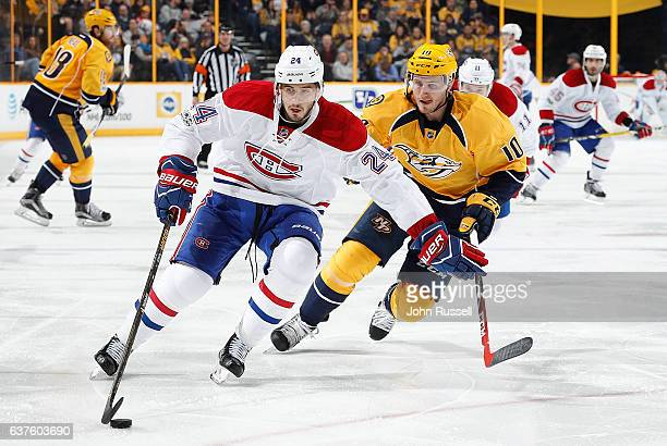Phillip Danault of the Montreal Canadiens skates against Colton Sissons of the Nashville Predators during an NHL game at Bridgestone Arena on January...