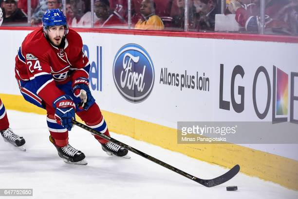 Phillip Danault of the Montreal Canadiens skates the puck around the boards during the NHL game against the Nashville Predators at the Bell Centre on...