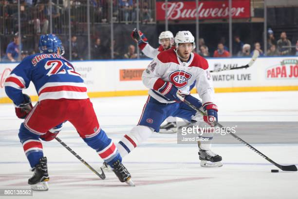 Phillip Danault of the Montreal Canadiens skates with the puck against Kevin Shattenkirk of the New York Rangers at Madison Square Garden on October...