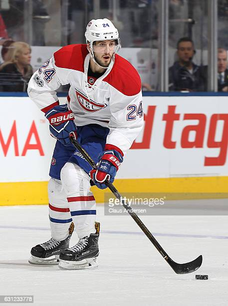 Phillip Danault of the Montreal Canadiens skates with the puck against the Toronto Maple Leafs during an NHL game at the Air Canada Centre on January...