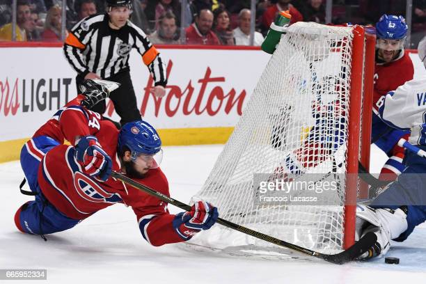 Phillip Danault of the Montreal Canadiens takes a shot on goal Andrei Vasilevskiy of the Tampa Bay Lightning in the NHL game at the Bell Centre on...