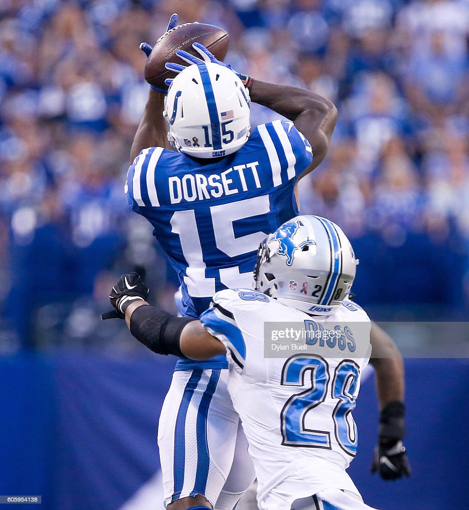 Phillip Dorsett #15 of the Indianapolis Colts makes a catch in front of Quandre Diggs #28 of the Detroit Lions in the fourth quarter at Lucas Oil Stadium on September 11, 2016 in Indianapolis, Indiana.