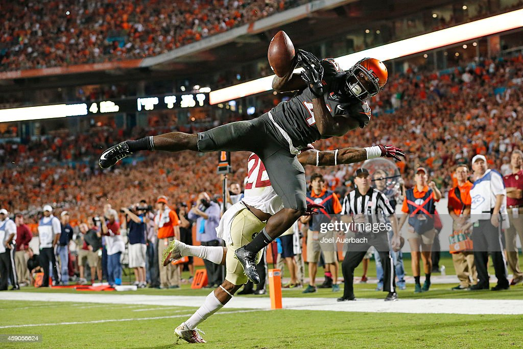 Phillip Dorsett of the Miami Hurricanes is unable to catch the ball for a touchdown while being defended by PJ Williams of the Florida State...