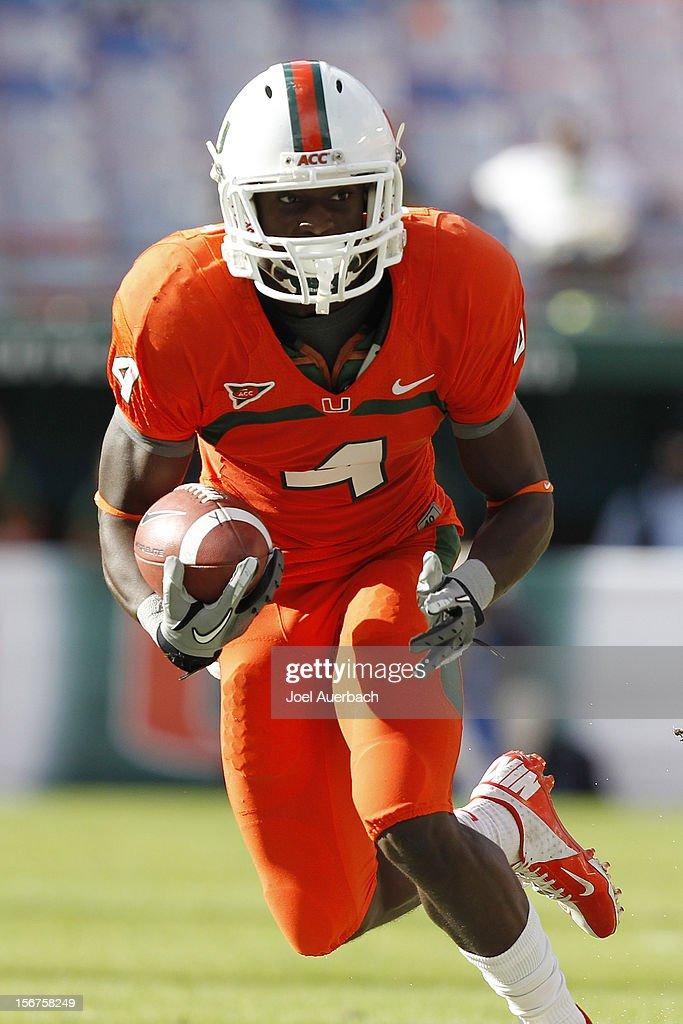 Phillip Dorsett #4 of the Miami Hurricanes runs with the ball against the South Florida Bulls on November 17, 2012 at Sun Life Stadium in Miami Gardens, Florida. The Hurricanes defeated the Bulls 40-9.