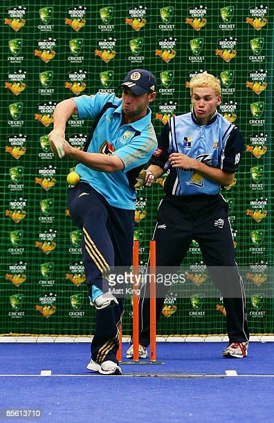 Phillip Hughes bats during a game of indoor cricket during the annoucement of a merger between Cricket Australia and Indoor Cricket at the...