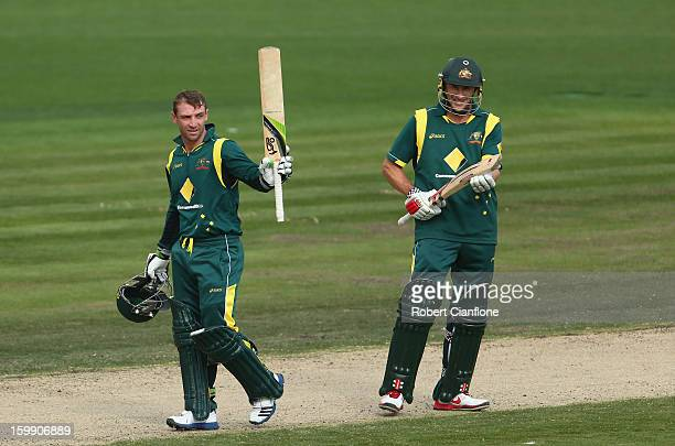 Phillip Hughes of Australia celebrates after scoring his century during game five of the Commonwealth Bank One Day International Series between...