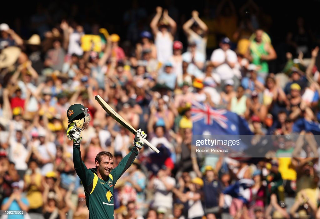 Phillip Hughes of Australia celebrates his century during game one of the Commonwealth Bank One Day International series between Australia and Sri Lanka at Melbourne Cricket Ground on January 11, 2013 in Melbourne, Australia.