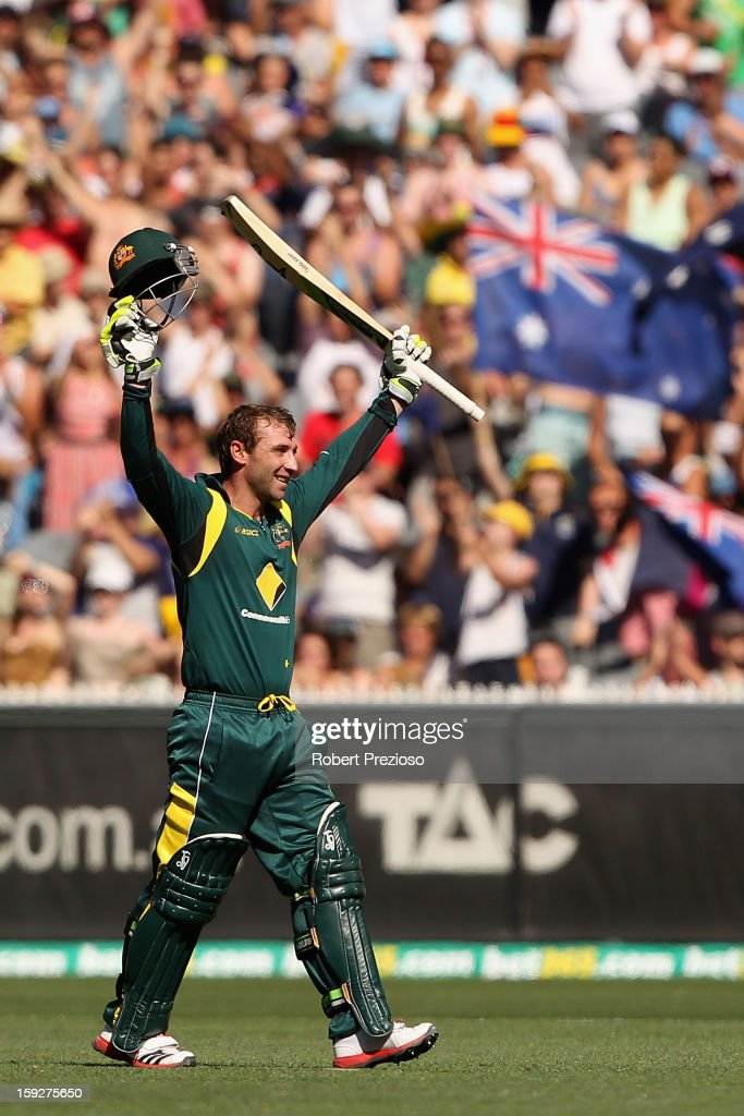 <a gi-track='captionPersonalityLinkClicked' href=/galleries/search?phrase=Phillip+Hughes+-+Cricketer&family=editorial&specificpeople=757530 ng-click='$event.stopPropagation()'>Phillip Hughes</a> of Australia celebrates his century during game one of the Commonwealth Bank One Day International series between Australia and Sri Lanka at Melbourne Cricket Ground on January 11, 2013 in Melbourne, Australia.