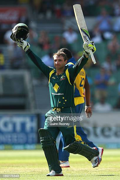 Phillip Hughes of Australia celebrates reaching 100 runs during game one of the Commonwealth Bank One Day International series between Australia and...